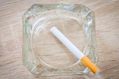 Cigarette in an ashtray Stock Photos