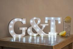 Illuminated Decorative Letters for Gin and Tonic - stock photo