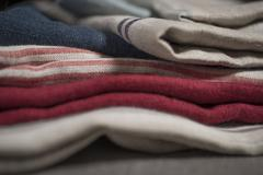 Fabric Swatch of Striped and Plain Cloth Stack - stock photo