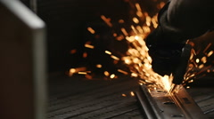 Worker using industrial grinder on metal rail track parts Stock Footage