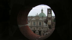 View of Vigevano Cathedral from a hole in red bricks, Vigevano, PV, Italy - stock footage