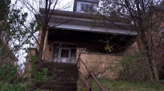 Abandoned Overgrown Home Establishing Shot Stock Footage
