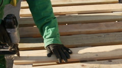 Construction worker using a nail gun Stock Footage