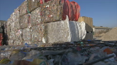 Forklift carriing plastic waste on the factory recycling area Stock Footage