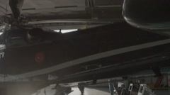 Black large helicopter filmed in hangar with Steadicam - stock footage