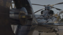 Detail shot of a landed helicopter in slow motion scene Stock Footage
