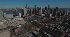 Jersey City Aerials Flying Towards Downtown Manhattan Viewing Baseball Field Stock Footage