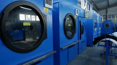 Huge Industrial washing machines with laundry Stock Footage