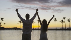 Success, celebrating concept with people cheering of joy bliss at beach sunset Stock Footage