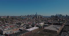 Hoboken NJ Aerial View Over Buildings Heading Towards Downtown Manhattan Stock Footage