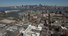 Hoboken NJ Aerial Flyover Buildings Towards Hudson River Stock Footage