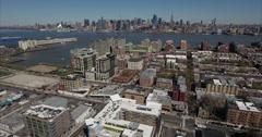 Hoboken NJ Aerial Flyover Buildings Towards Hudson River - stock footage