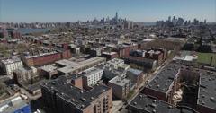Hoboken NJ Flyover Of Apartment Complexes Towards Hudson River Stock Footage
