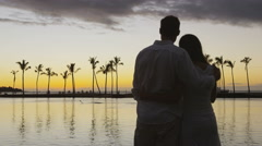 Romantic sunset happy couple in love enjoying beach vacation on Hawaii - stock footage