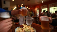 Cheers hands raise glasses of beer Stock Footage