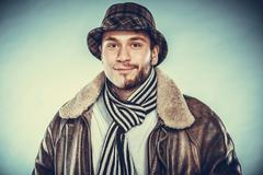 Happy man with half shaved face beard hair in hat. Stock Photos