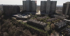 Cliffside Park NJ Flyover Trees Towards Apartment Complexes Stock Footage