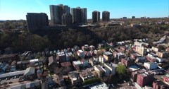 Cliffside Park NJ Flying Over Homes Towards Apartment Buildings With Blue Skies Stock Footage