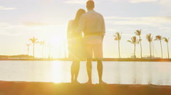 Honeymoon couple romantic at sunset happy in love enjoying vacation at beach - stock footage