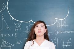 Beautiful asian girl teacher and green blackboard with cloud and math Stock Photos