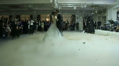 Beautiful young model couple just married and dancing their first dance in the Stock Footage