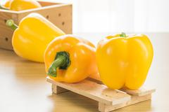 Bell peppers wood tray - stock photo