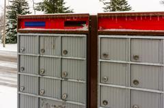 Suburban  group mailboxes - stock photo