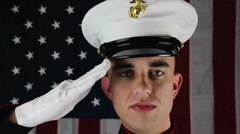 Marine In Salute With American Flag In Background - stock footage