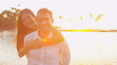 Couple portrait romantic at sunset happy in love embracing looking at camera Stock Footage