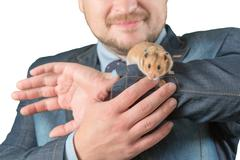 Man holding hamster on arm - stock photo
