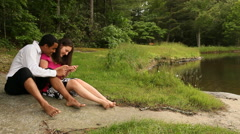 Mixed Couple Spending Time Together Outdoors - stock footage