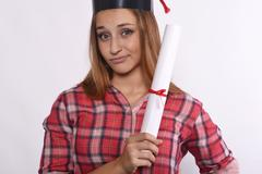Student with diploma and graduation cap - stock photo