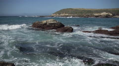 Waves wash over shallow rocks near Spooner's Cov Stock Footage