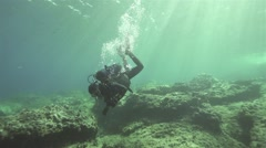 Diver releases oxygen bubbles of super slow motion Stock Footage