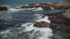 Cloe up view of waves crashing on rocks near Spooner's Cove Stock Footage