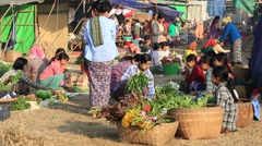 Burmese people buy and sell products on street food market. Myanmar, Burma Stock Footage