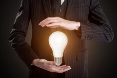 Lightening bulb in man's hands Kuvituskuvat