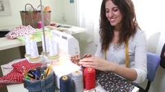 Seamstress sewing in her studio Stock Footage