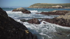Waves on jagged rocks near Spooner's Cove Stock Footage