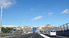 Road sign with direction to Santa Cruz. Main highway TF-1 Autopista del Sur Stock Footage