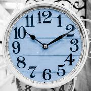 Light blue clock in a classical style. Stock Photos