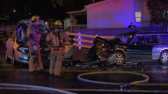Head On Car Crash With Firefighters On Scene Stock Footage