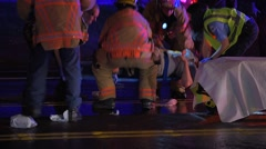 Firefighters And Medics Transporting A Patient After A Car Crash Stock Footage