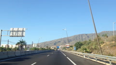 Road sign with direction to Costa Adeje. Main highway TF-1 Autopista del Sur Stock Footage