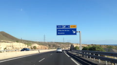 Vehicles drive on main highway TF-1 Autopista del Sur. Tenerife Stock Footage