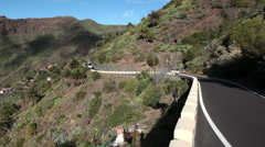Small bus and car pass narrow place on the TF-436 road, Masca. Tenerife Stock Footage