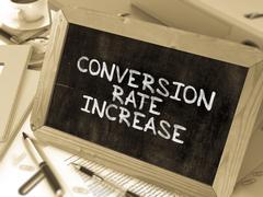 Conversion Rate Increase Handwritten on Chalkboard - stock illustration