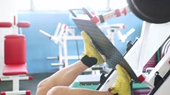 Attractive Young Man Doing Leg Press On Machine In Gym Stock Footage
