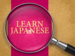 Learn Japanese through Magnifying Glass - stock illustration