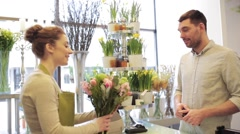Florist woman with flowers and man at flower shop Stock Footage